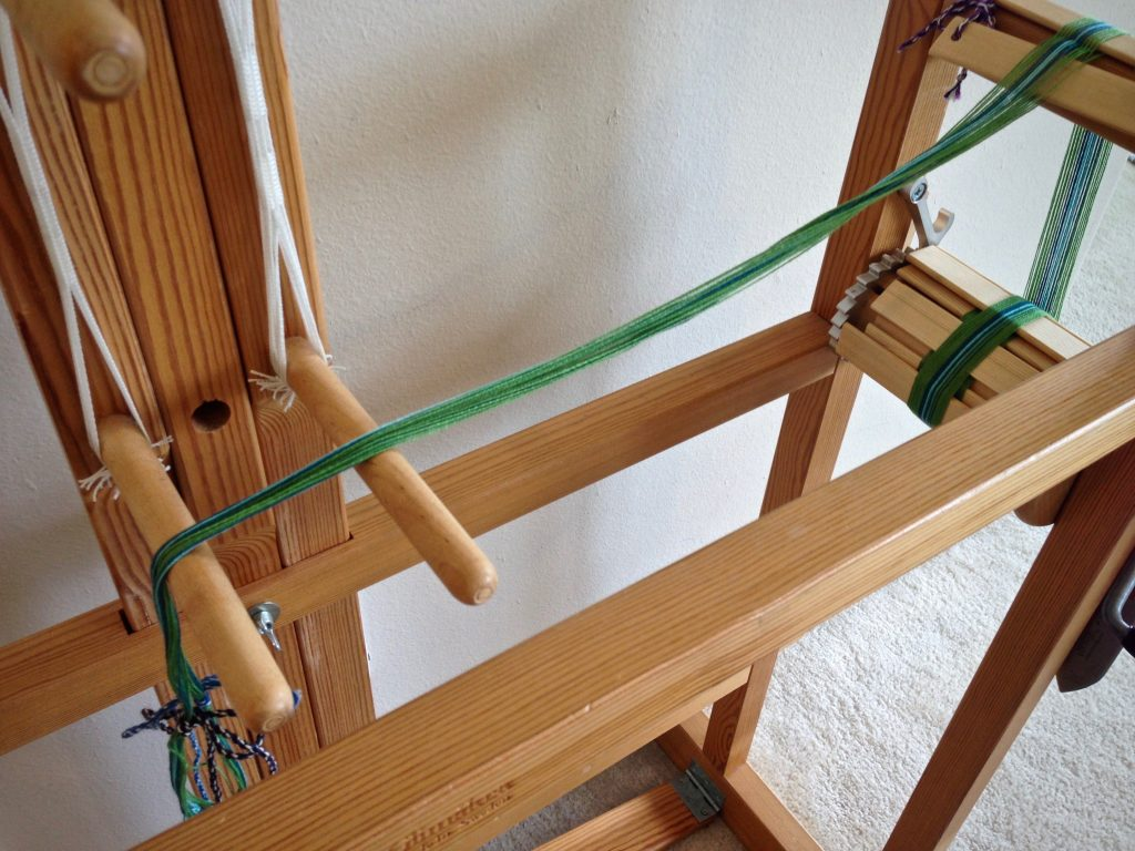 Warping the Glimakra band loom.