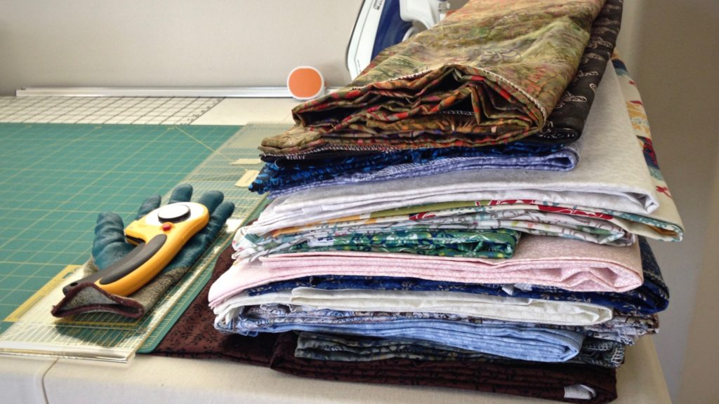 Piles of fabric for making patterned rag rugs.