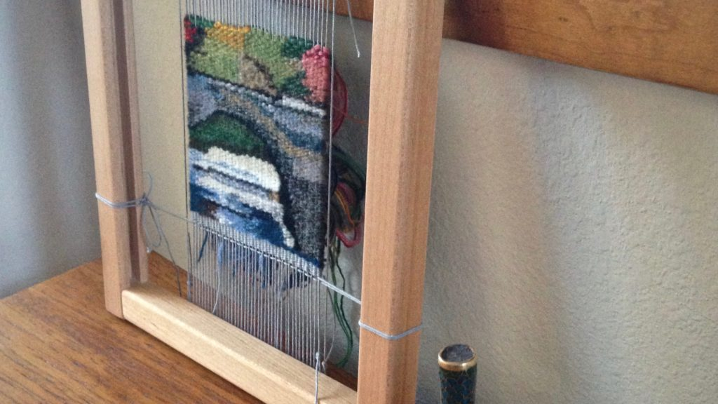 Building a bridge. Small tapestry.
