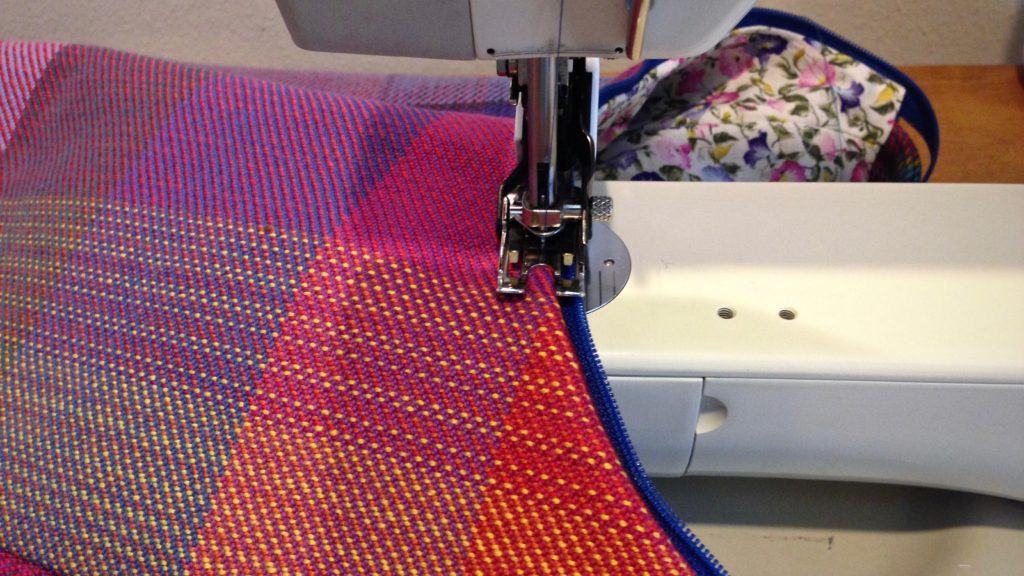 Making a handbag from handwoven fabric.