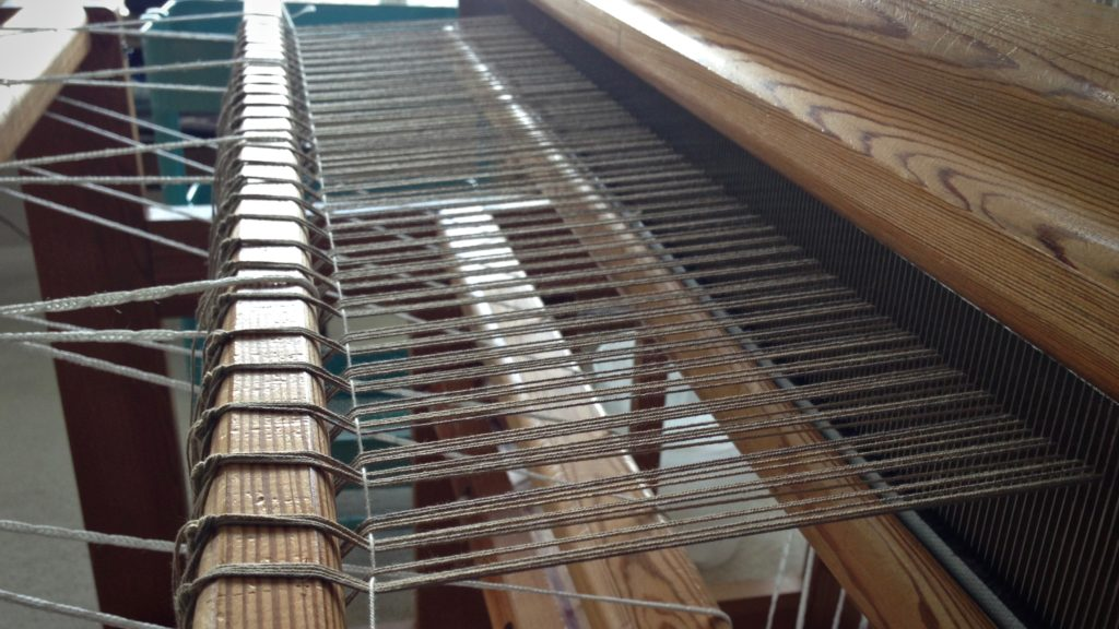 This is when the loom looks like a musical instrument, ready to be strummed.