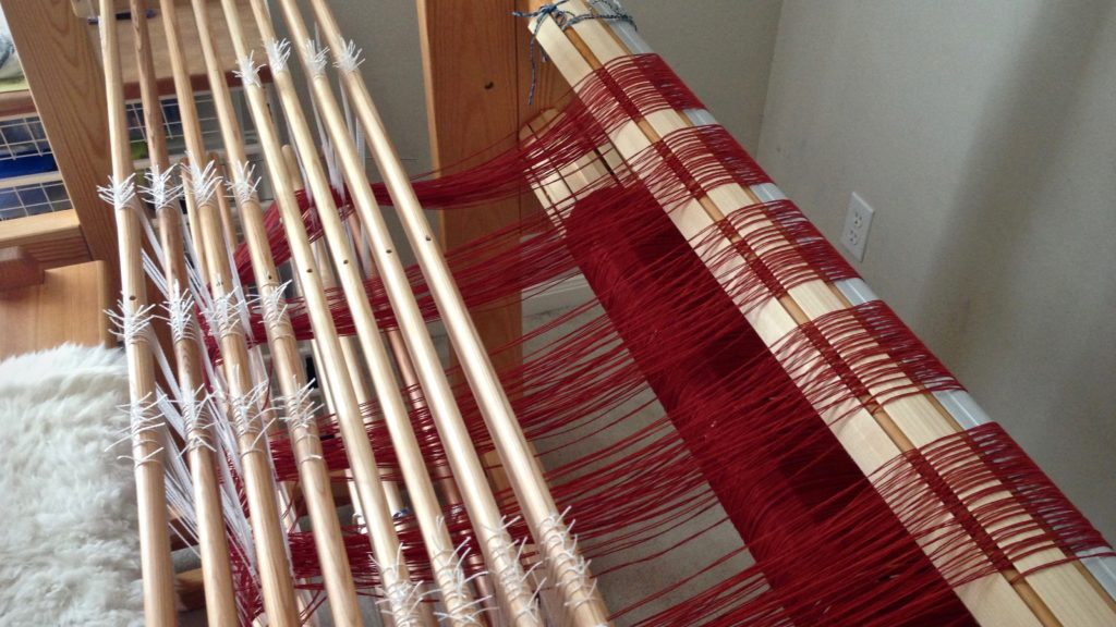 Threading the loom for an eight-shaft double binding rag rug.