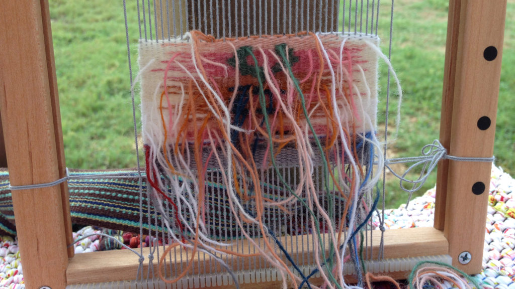 Small tapestry. Weaving from the back.