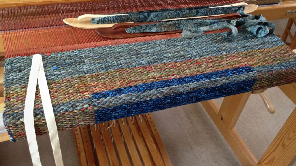 Double binding rag rug in the making.