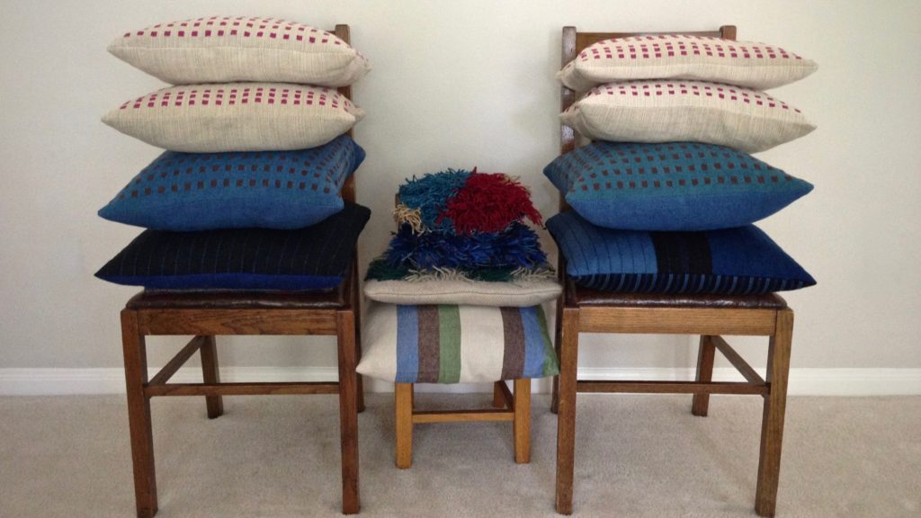 Thirteen cushions, all handwoven. Karen Isenhower