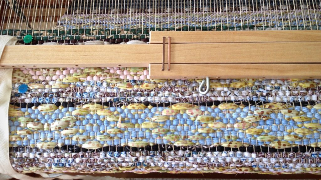 Classic rosepath motif in a rag rug on the loom.