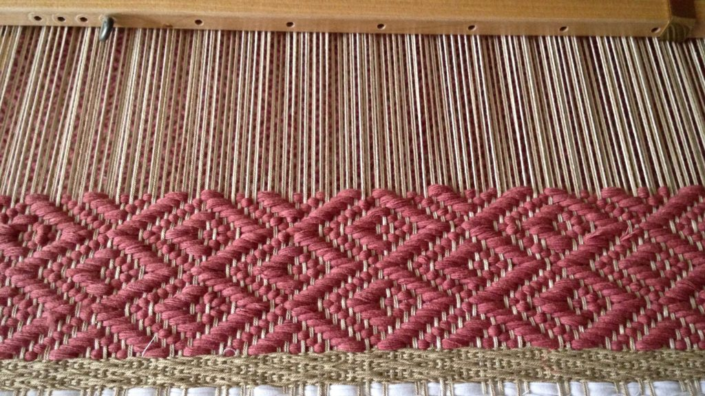 Stringyarn weft for 8-shaft block twill rug.