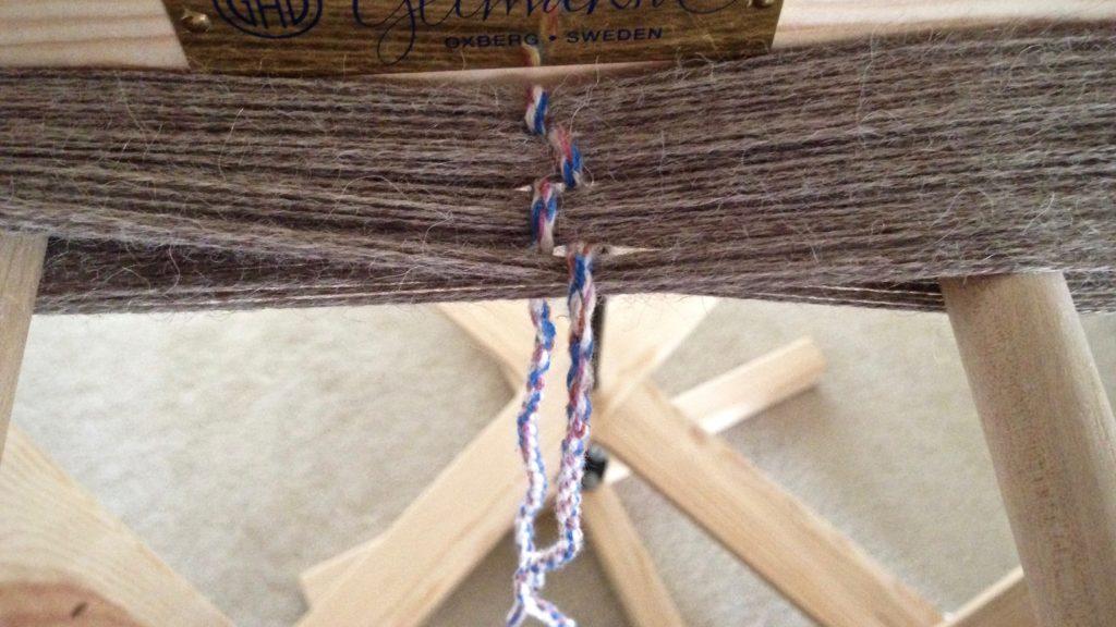Winding a warp of alpaca yarn for scarves.