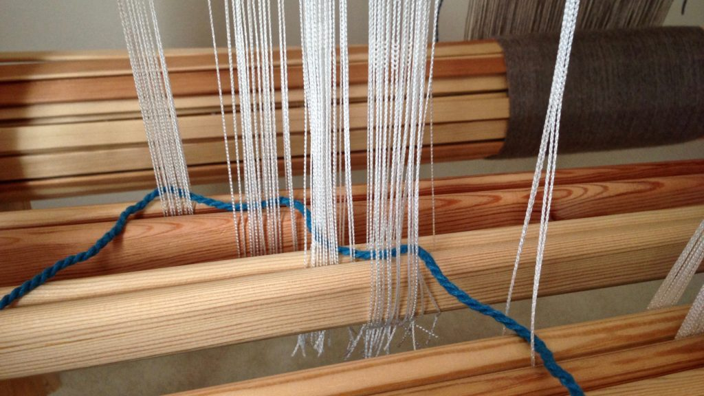 Removing Texsolv heddles from multiple shafts.