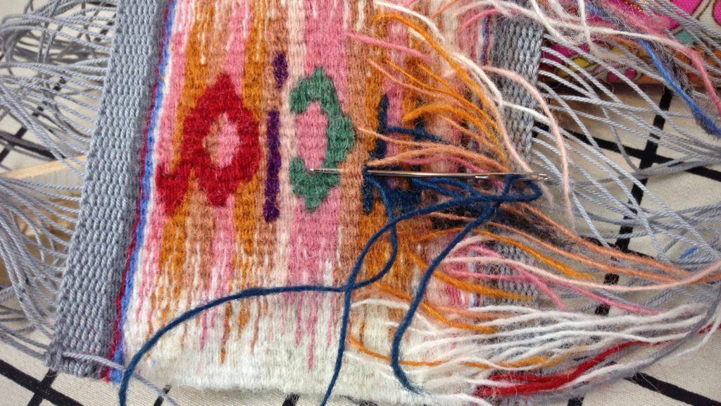 Back of tapestry, sewing in weft tails.