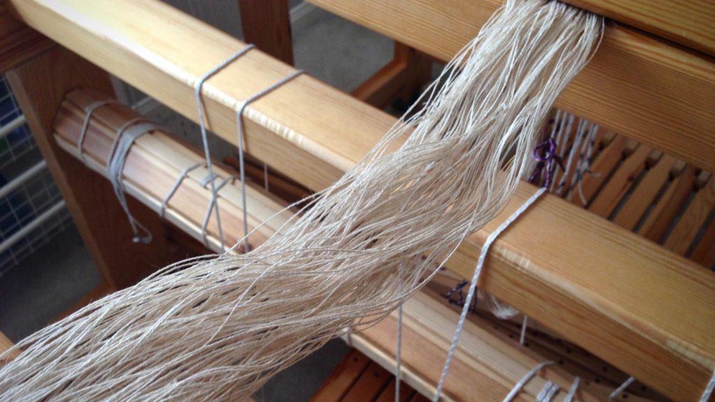 Preparing to beam a linen warp.
