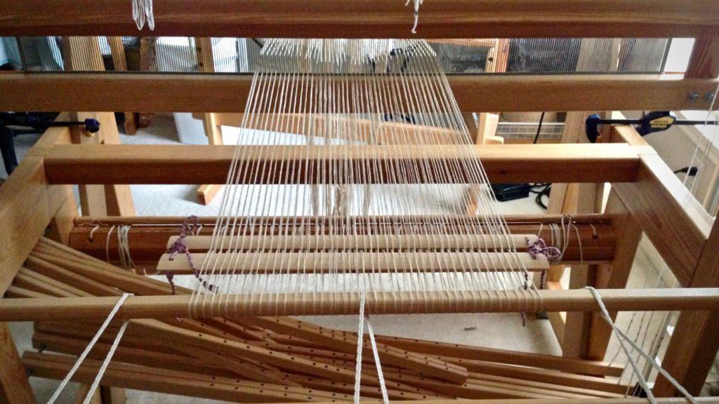 Beginning to beam a linen warp.