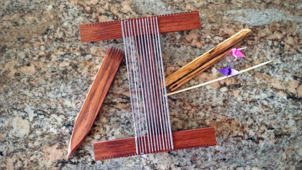 Hockett loom warped for weaving a small tapestry.