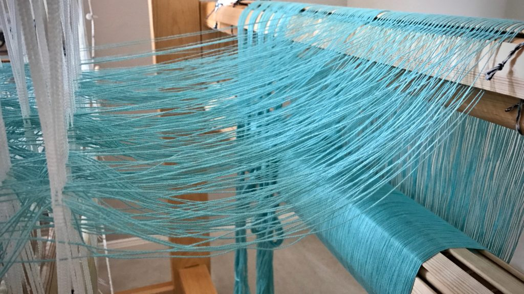 Aquamarine cotton. Threading my Glimakra Standard loom.