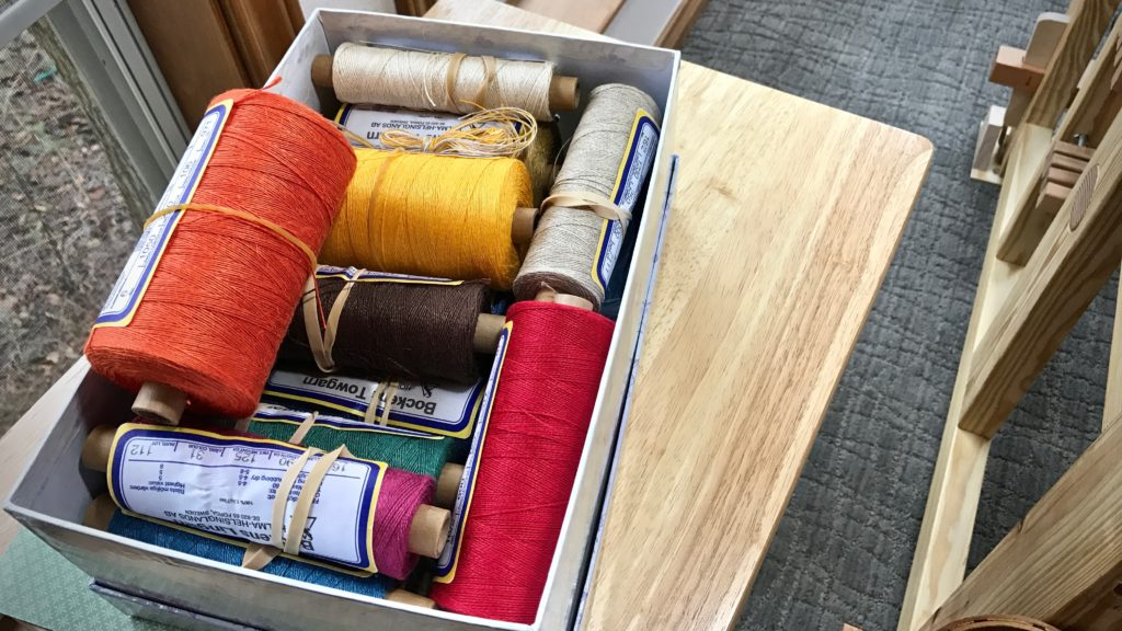 Box of colorful linen for a tapestry project!