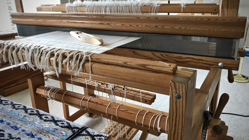 Beginning cotton warp with M's and O's.