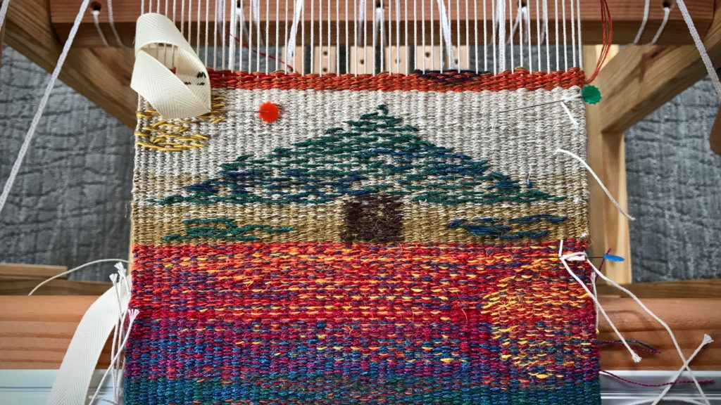 Tapestry and inlay sampler. Spliced warp ends fix frayed threads.