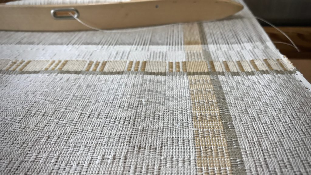 Weaving M's and O's with linen weft.