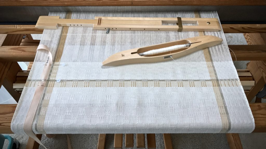 Weaving the border of the long table runner. M's and O's.