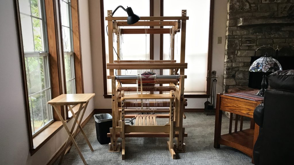 Sweet little hand-made loom.