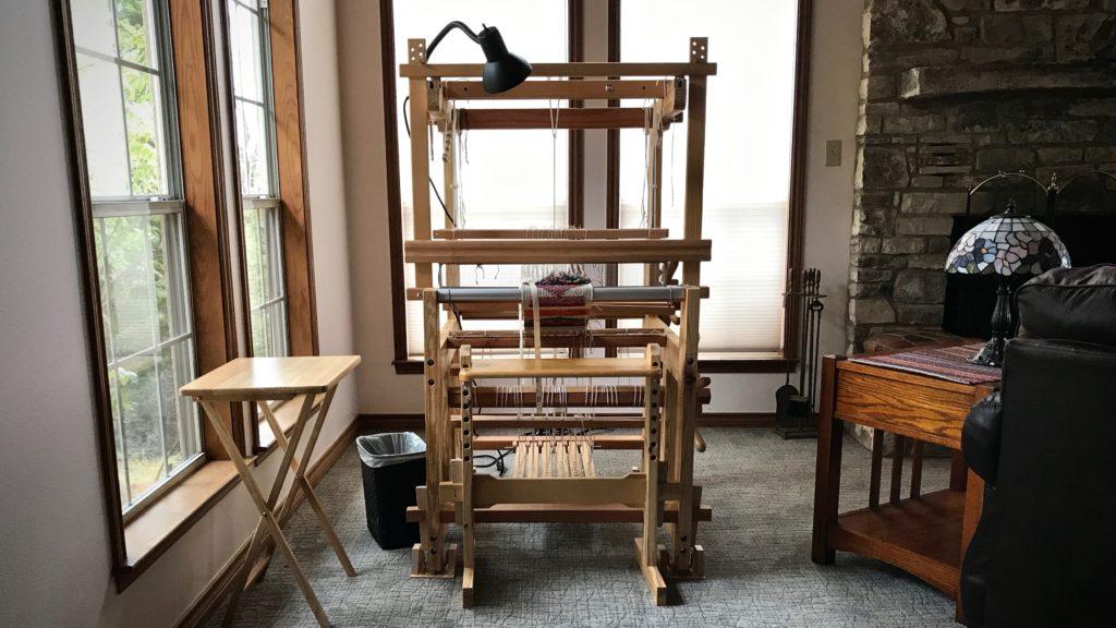 Sweet little hand-made loom.