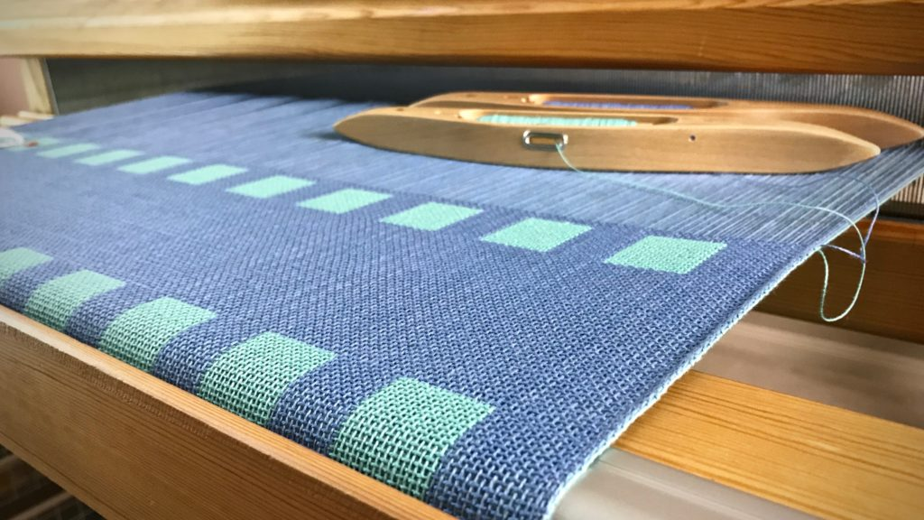 Double weave cotton baby blanket on the loom.