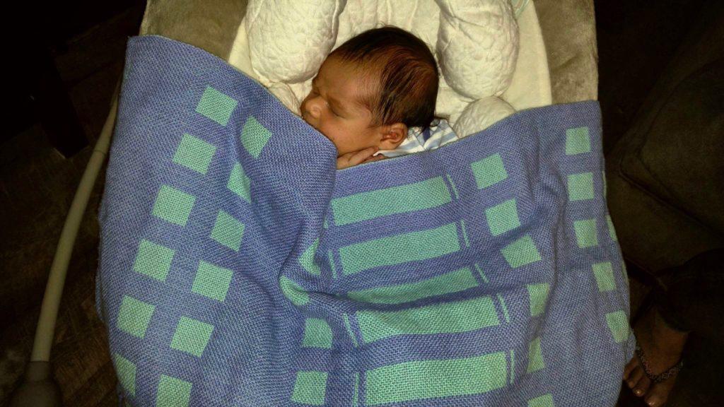 Handwoven baby blanket for newborn.