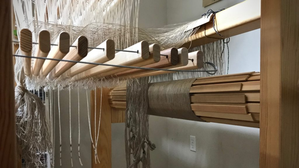 Threading linen on ten shafts.