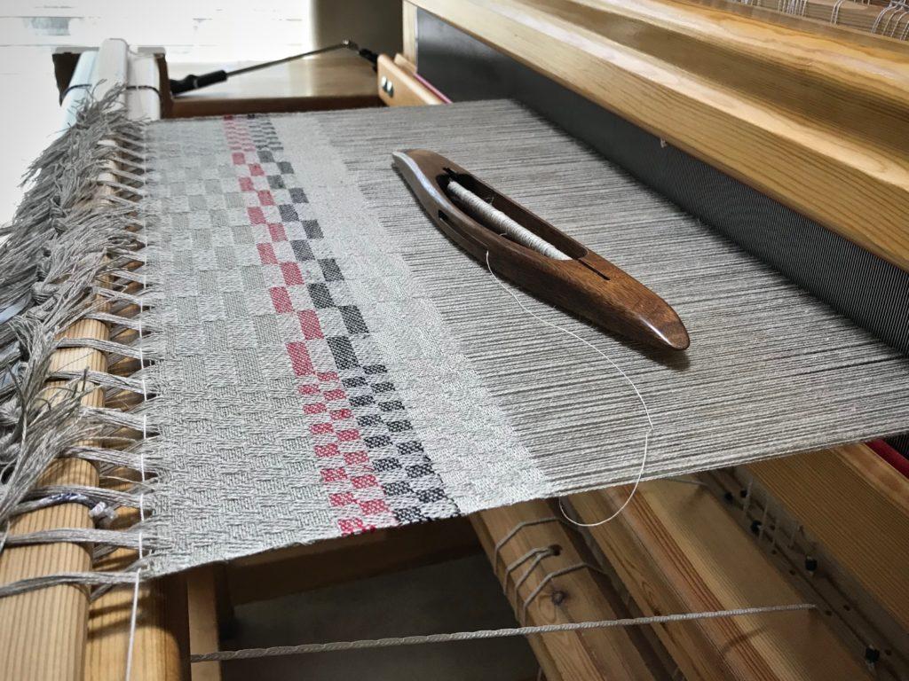 Sampling weft colors on a linen warp.