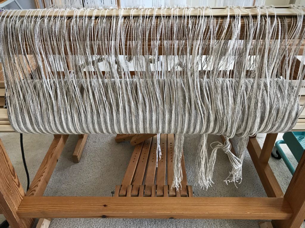 Stripes on the warp beam are so enticing! Linen.