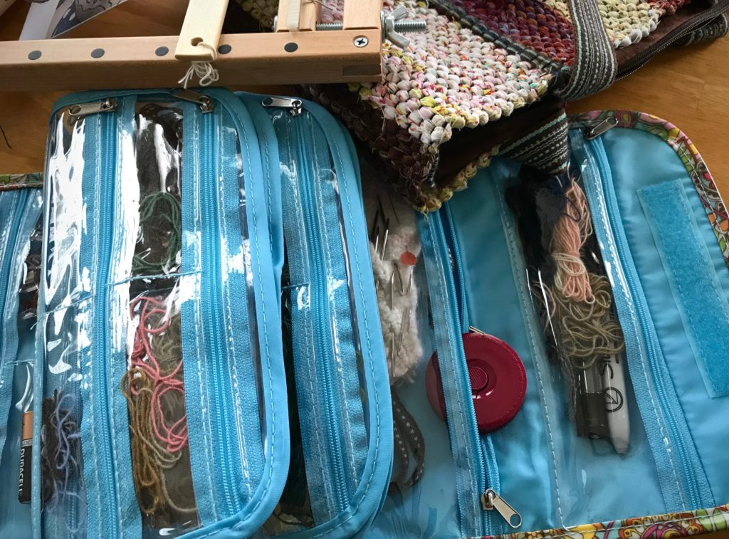 Travel tapestry supplies, including tape measure.
