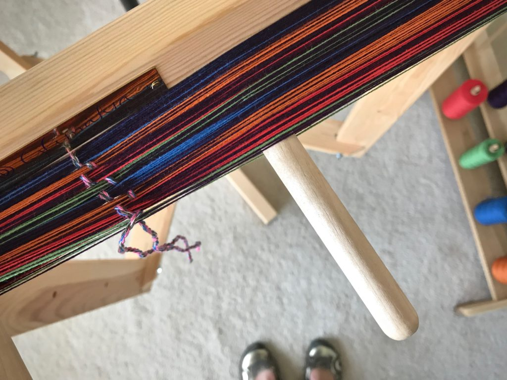 Winding a colorful warp.