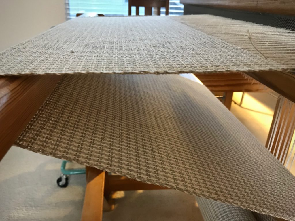 Linen upholstery fabric on the loom.