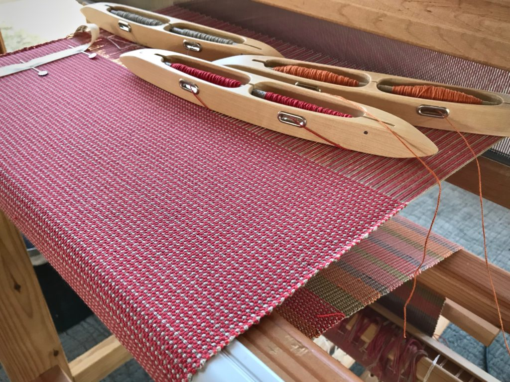 Double-bobbin shuttles for weaving doubled weft.