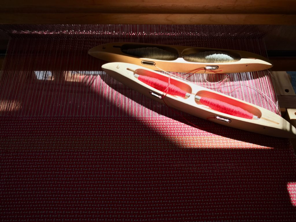 Cotton placemats on the loom with color and weave effects.