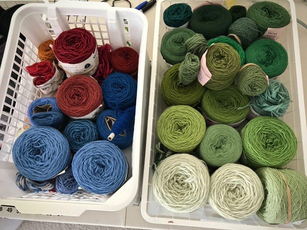 Wool being sorted for 4-shaft tapestry.