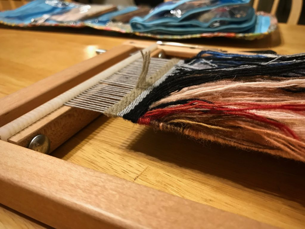 Ending a small frame loom tapestry.