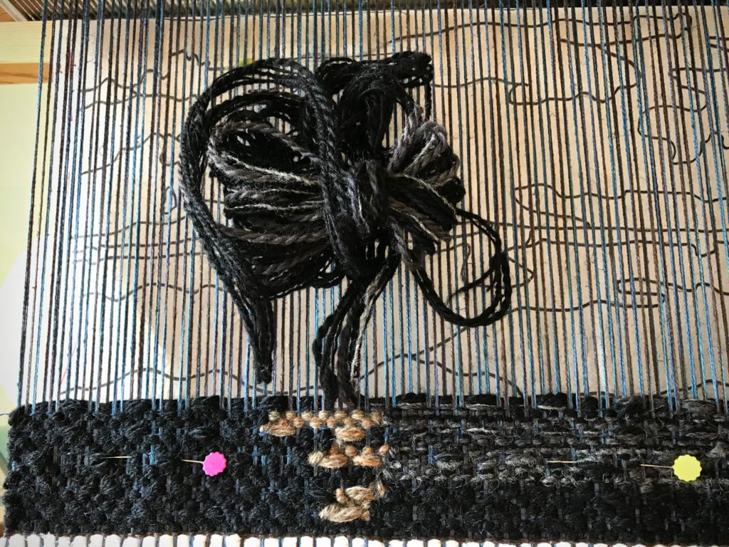 Beginning of a four-shaft tapestry.
