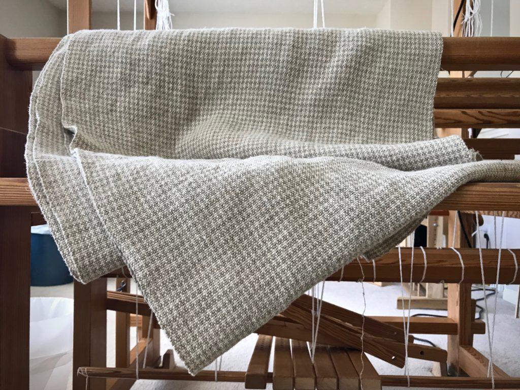 Handwoven linen upholstery fabric.
