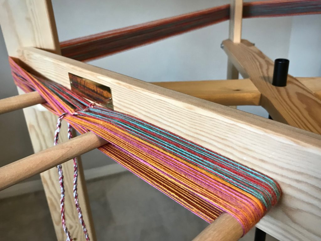 Warping reel. Winding a new colorful warp!