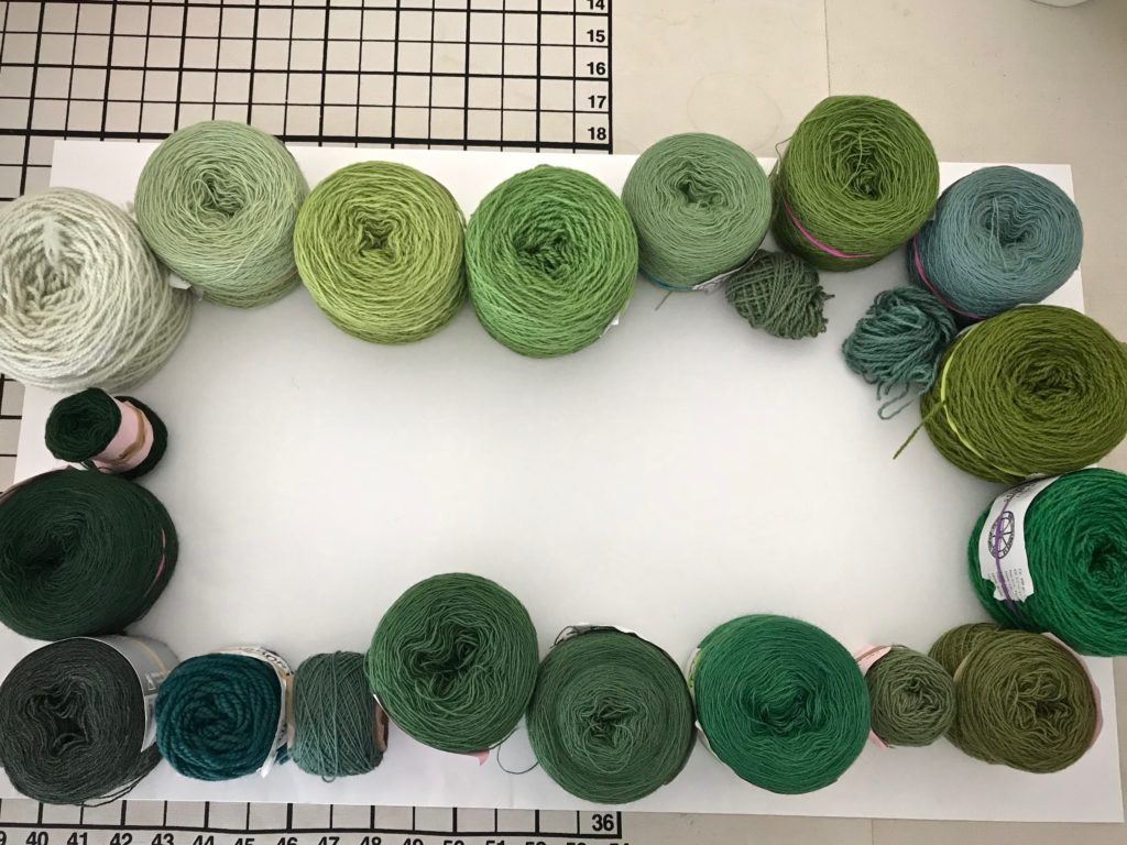 Arranging yarn by color value for tapestry.