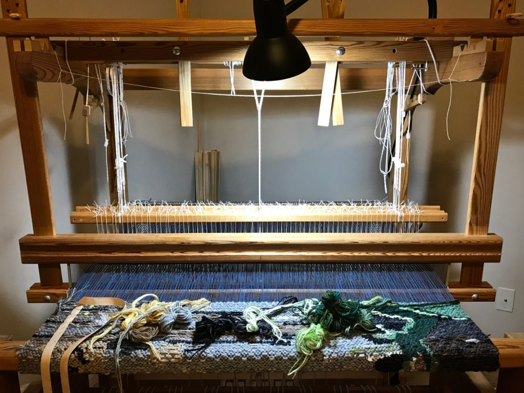 Getting ready to dismantle loom for relocation.