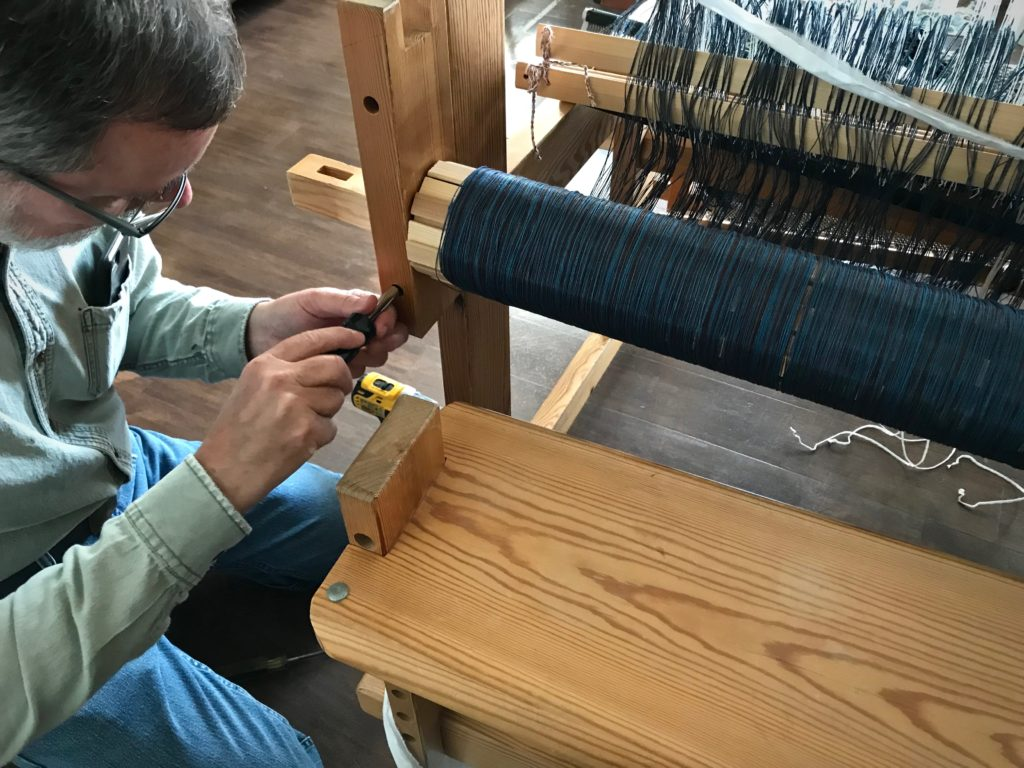 Re-assembling my loom after relocating.