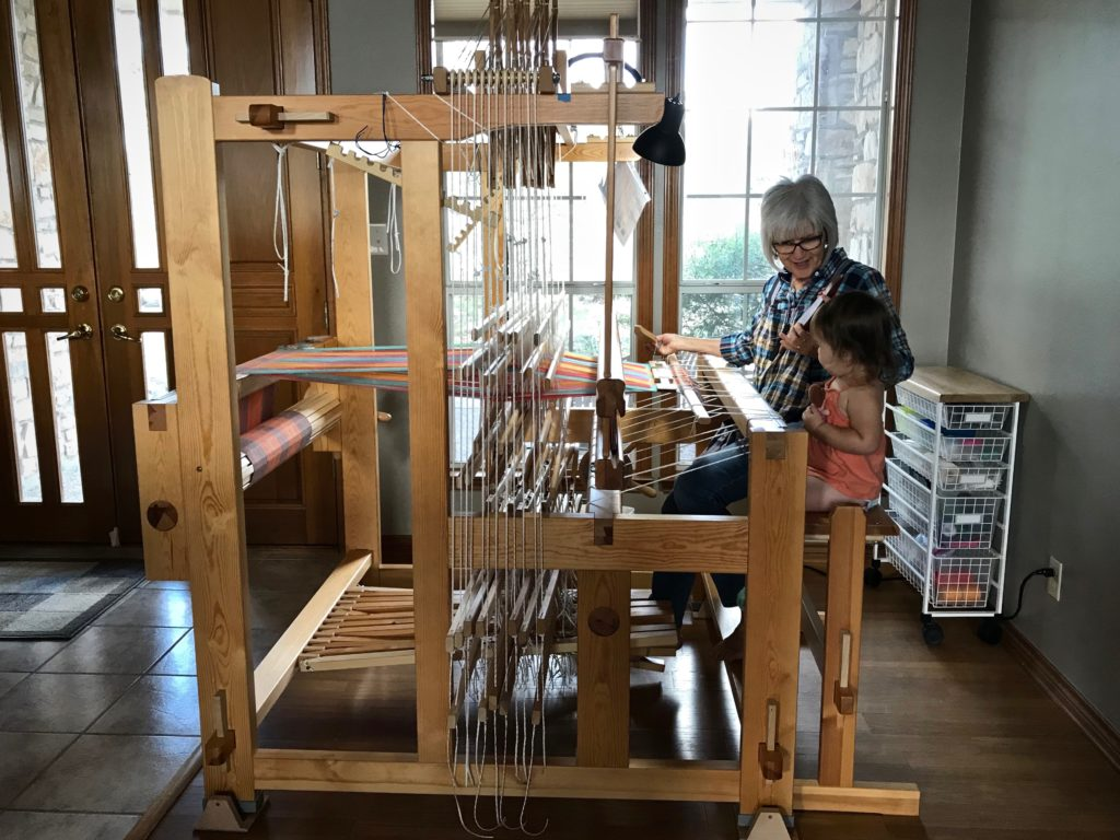 Weaving with my granddaughter at my side.