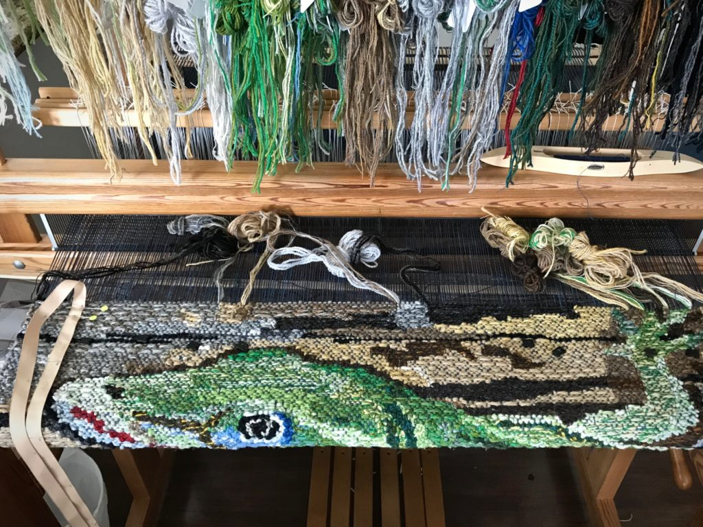 Lizard tapestry. Only the tips of the toes are left.