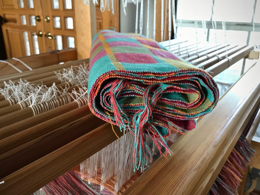Freshly woven towels, ready for finishing work.
