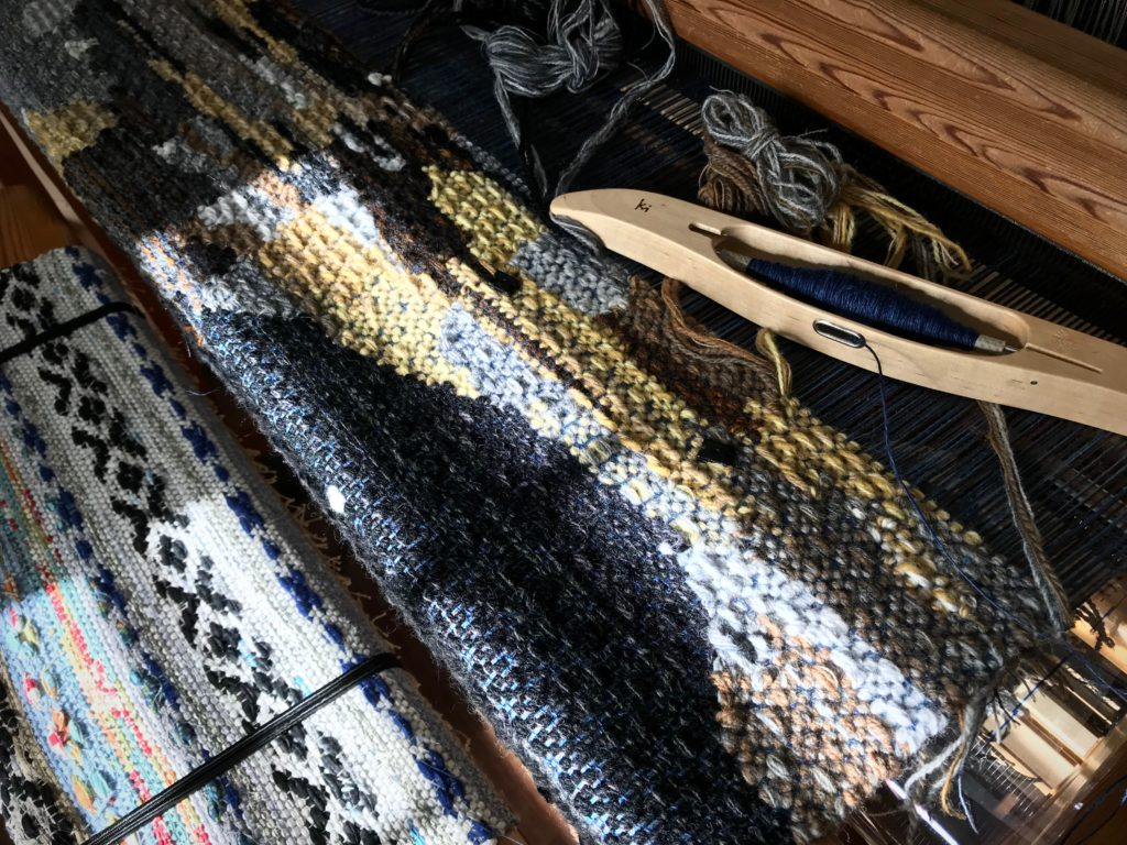 Afternoon sun on the wool tapestry image.