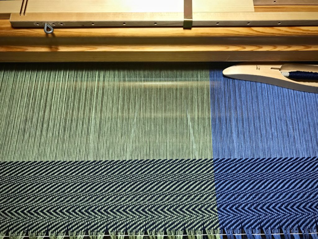 Sampling before weaving a cotton throw.