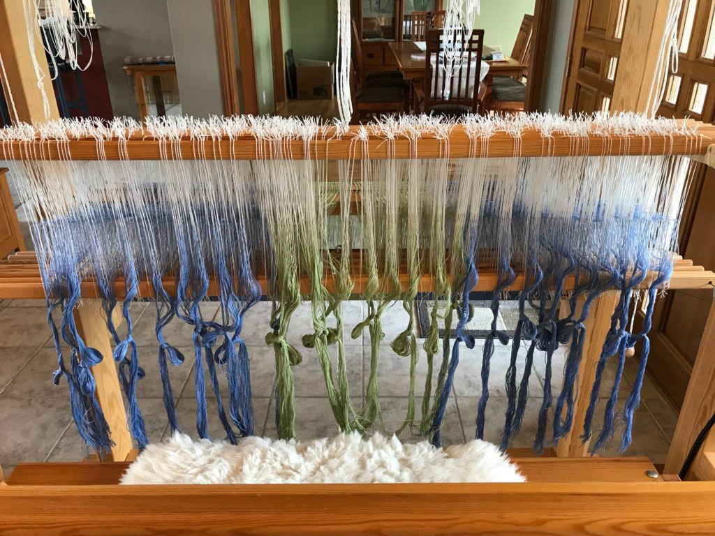 Heddles are threaded.