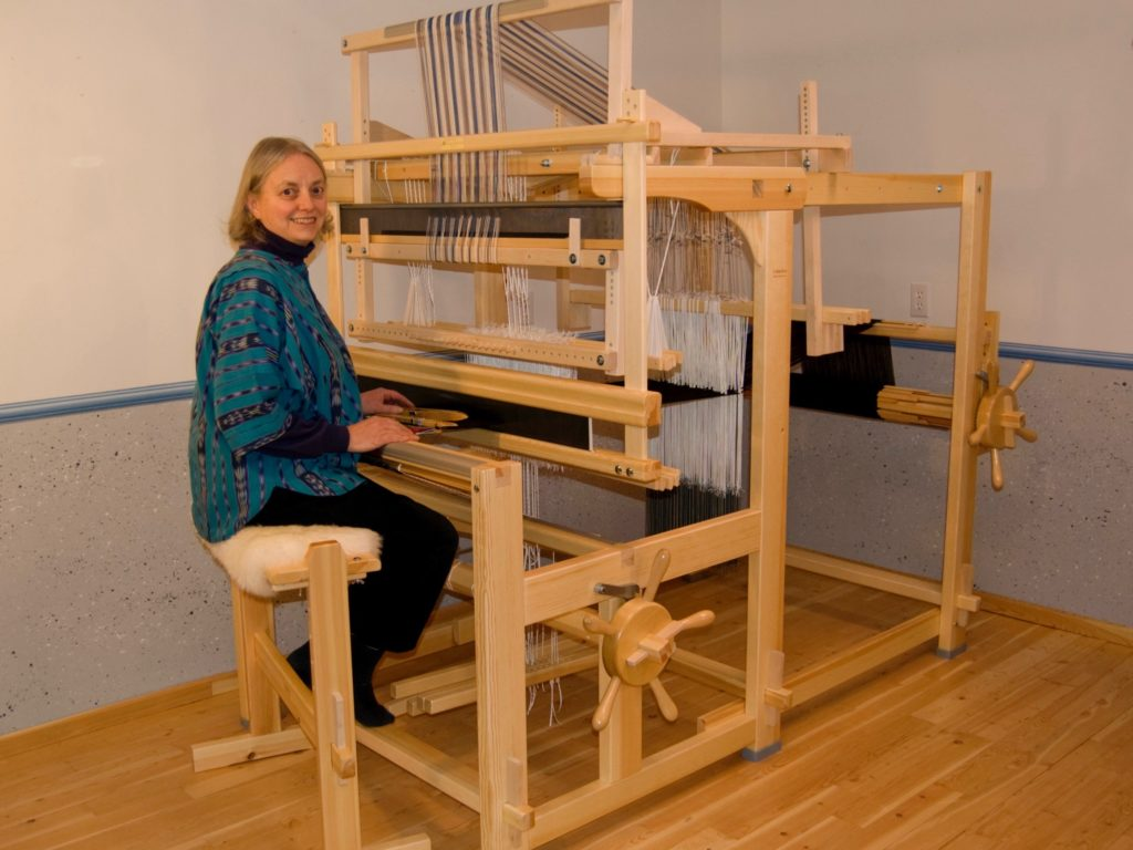 Joanne Hall at her single unit drawloom.